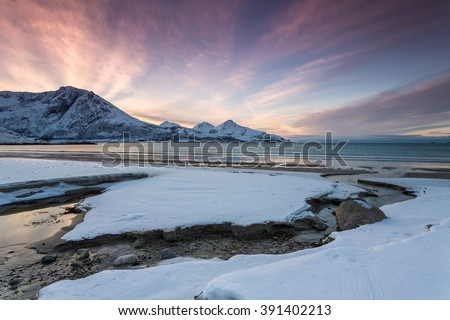 Scenery of fjord with high mountain in winter, Lyngsalpene, Norway