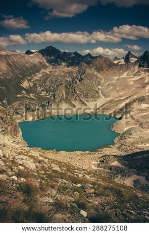 Scenery of high mountain with lake and high peak. Landscape - a clear day in the mountains - stock photo
