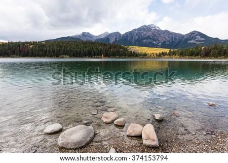 Scenery of high mountain with Patricia Lake, Jasper National Park, Alberta, Canada - stock photo
