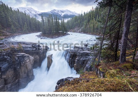 Scenery of high mountain with Sunwapta Falls, Jasper National Park, Alberta, Canada - stock photo