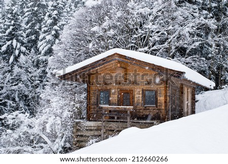 Scenery Of Small Wood Chalet Over Snow Covered Trees On Slope Austrian Ski Resort