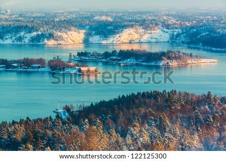 Scenery of winter sunset in Scandinavian fjords - stock photo