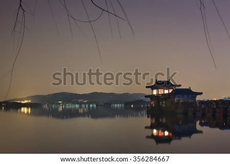 Scenery reflected in a quiet West lake at night, Hangzhou, China