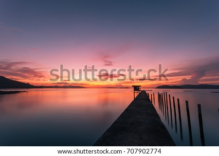 scenery view of old jetty to the sea beautiful sunrise or sunset in phuket thailand