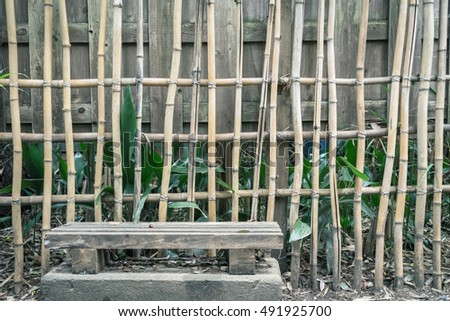 Scenery with the bench / front of bamboo fence