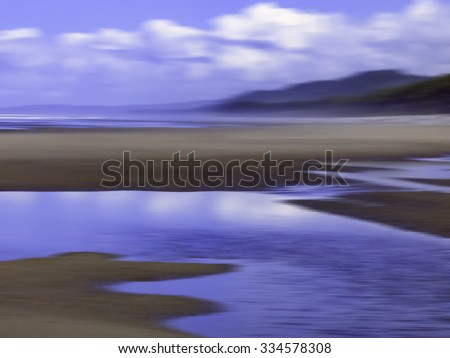 Scenic abstract of sandy beach with reflective tide pools along Pacific coast of Olympic Peninsula in Washington, USA, for themes of nature, transience, the environment - stock photo