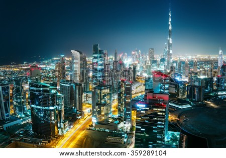 Scenic aerial cityscape at night with illuminated modern architecture. Downtown of Dubai, United Arab Emirates.