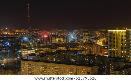 Scenic aerial cityscape at night with illuminated modern architecture. Voronezh, Russia.