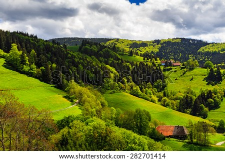 Scenic aerial landscape with picturesque mountain village in summer. Germany, Schwarzwald. - stock photo