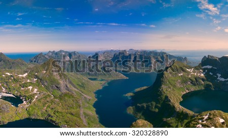 Scenic aerial panorama of amazing Lofoten islands in Norway, famous for its fjords, dramatic peaks and natural beauty - stock photo