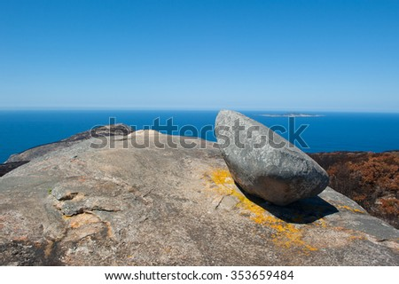 Scenic aerial panorama view along coast of Torndirrup National Park, Albany, Western Australia, burnt vegetation, Southern Ocean, blue sky, copy space. - stock photo