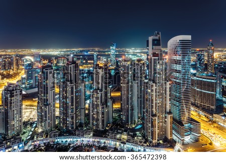 Scenic aerial view of Dubai's business bay architecture by night with residential buildings. - stock photo