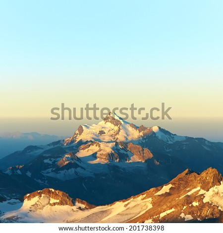 scenic alpine landscape with and mountain ranges. natural mountain background - stock photo