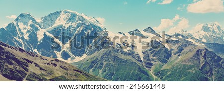scenic alpine landscape with mountain ranges. natural mountain background - stock photo