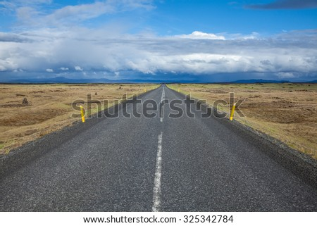 Scenic asphalt road in Iceland - stock photo