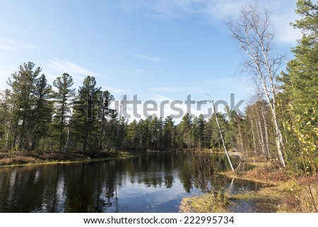 scenic autumn landscape of river and trees in northern Russia - stock photo