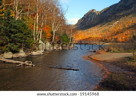 """Scenic autumn view of Profile Lake in New Hampshire.  Site of the """"Old Man in the Mountain"""" rock, which fell in 2003. - stock photo"""