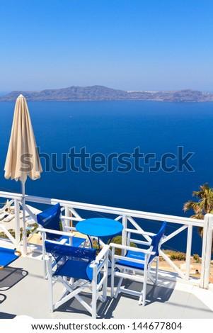 Scenic cafe tables on Santorini island, Greece - stock photo
