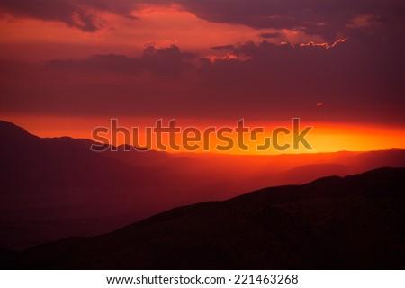Scenic California Sunset. Coachella Valley Summer Sunset. Valley Landscape. San Jacinto Mountains View from Little San Bernardino Mountain Vista Point. - stock photo