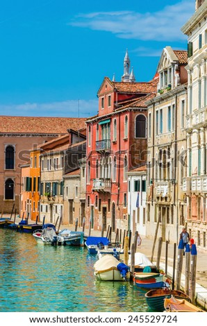 Scenic canal with boats, Venice, Italy  - stock photo