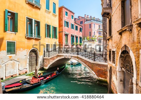 Scenic canal with bridge and colorful buildings in Venice, Italy - stock photo