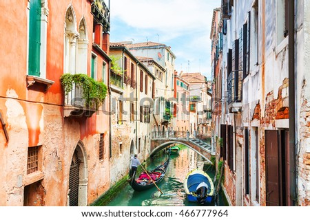Scenic canal with gondola and colorful buildings in Venice, Italy
