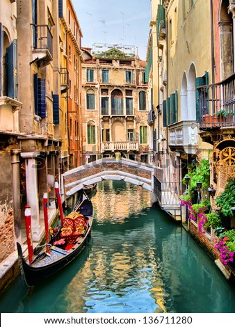 Scenic canal with gondola, Venice, Italy - stock photo