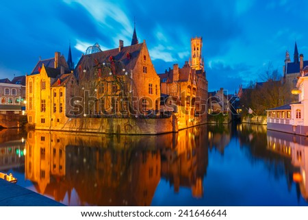 Scenic cityscape with a medieval fairytale town and tower Belfort from the quay Rosary (Rozenhoedkaai) at sunset in Bruges, Belgium - stock photo