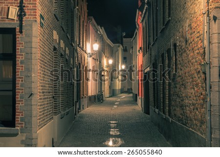 Scenic cityscape with a medieval fairytale town at night in Bruges, Belgium - stock photo