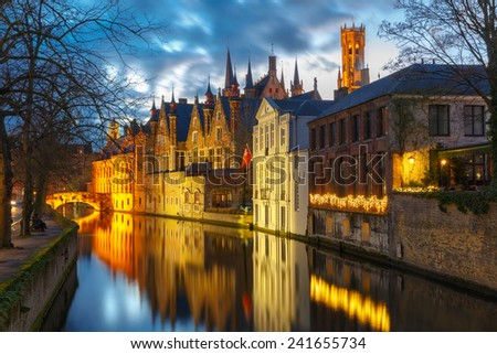 Scenic cityscape with a medieval tower Belfort and the Green canal (Groenerei)  at sunset in Bruges, Belgium - stock photo