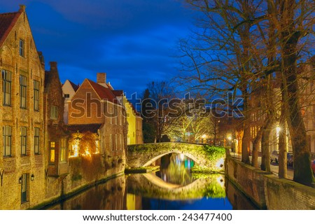 Scenic cityscape with a medieval tower Belfort and the Green canal, Groenerei,  at sunset in Bruges, Belgium - stock photo