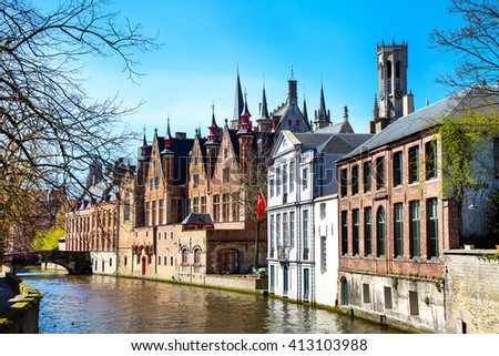 Scenic cityscape with a medieval tower Belfort and the Green canal, Groenerei, in Bruges, Belgium - stock photo