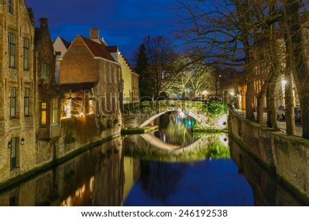 Scenic cityscape with a medieval town and the Green canal, Groenerei, at night in Bruges, Belgium - stock photo