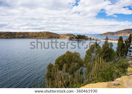 Scenic dramatic sky in winter season at Challapampa Bay on Island of the Sun, Titicaca Lake, among the most scenic travel destination in Bolivia. - stock photo