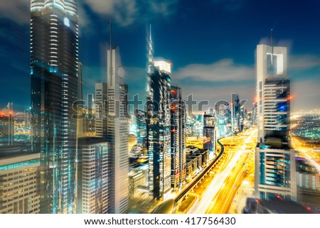 Scenic Dubai downtown architecture in the evening. View over Sheikh Zayed road with illuminated skyscrapers. Travel background.  - stock photo
