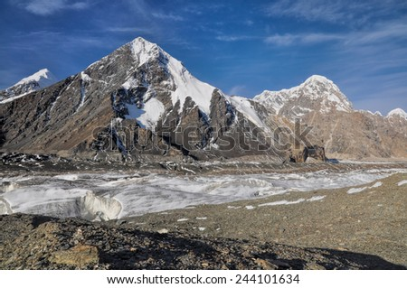 Scenic Engilchek glacier with picturesque Tian Shan mountain range in Kyrgyzstan
