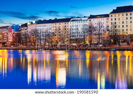 Scenic evening panorama of sea pier illuminated architecture in Hakaniemi district in Helsinki, Finland - stock photo