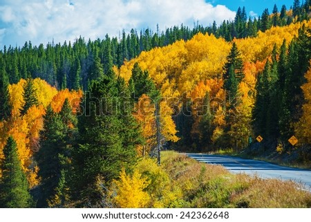 Scenic Fall Colorado Road. Autumn in Colorado Rocky Mountains. - stock photo