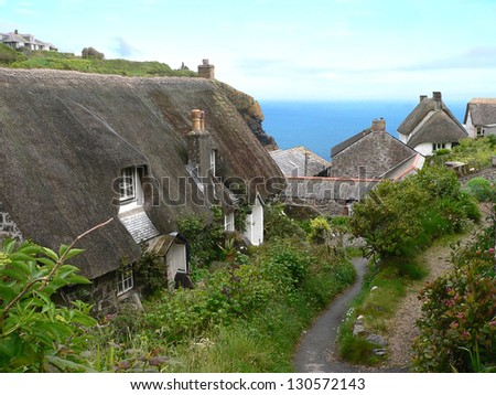 scenic fishermen village, thatched houses and romantic footpath to ocean, cadgwith village,  south england