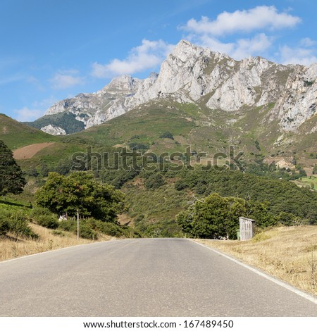 Scenic highway that leads to high mountains of northern Spain - stock photo