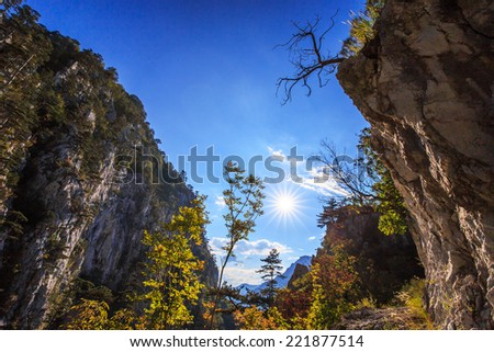 Scenic hiking path in the mountains in autumn - stock photo