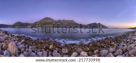 Scenic Hout Bay is a lively coastal town in cape Town South Africa, with a lovely swimming beach and a picturesque harbour where you can buy some of the best fish and chips in the world - stock photo