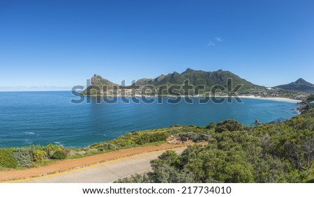 Scenic Hout Bay is a lively coastal town in cape Town South Africa, with a lovely swimming beach and a picturesque harbour where you can buy some of the best fish and chips in the world