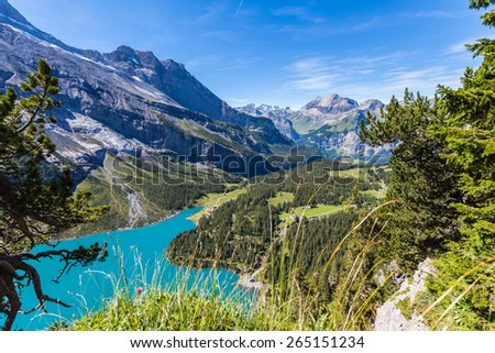 Scenic iew of Oeschinensee (Oeschinen lake) and the valley on bernese oberland, Switzerland - stock photo