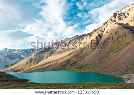 Scenic india himalayas mountains with Chandra Tal lake in Spiti valley landscape - stock photo