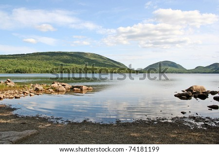 Scenic lake in Maine at Acadia National Park with reflection of sky
