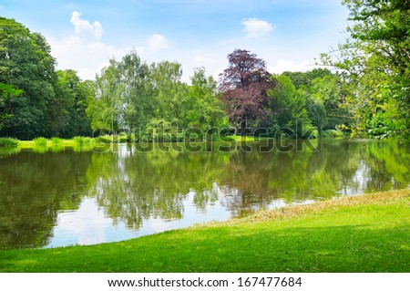 scenic lake in the summer park - stock photo