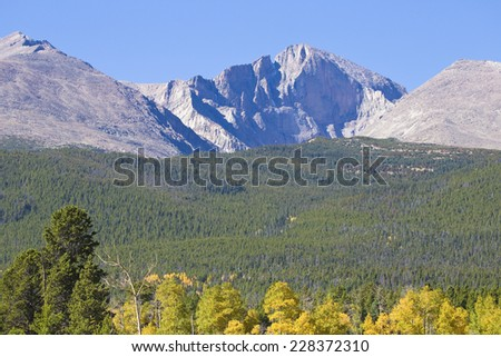 Scenic landscape autumn season view of the Colorado Rocky Mountains Longs Peak showing the inverted diamond on the east face.,    - stock photo
