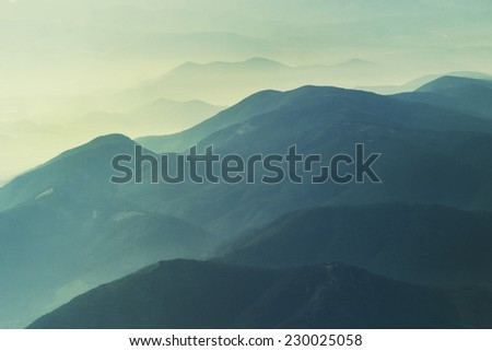 Scenic Landscape Mountains. Sunrise Layers. grain added - stock photo