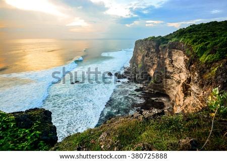 Scenic landscape of high cliff and tropical sea at Uluwatu Temple, Bali, Indonesia - stock photo